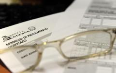 Omesso versamento IVA ed attenuante per l'estinzione del debito - Cassazione sentenza n. 5681 del 2014